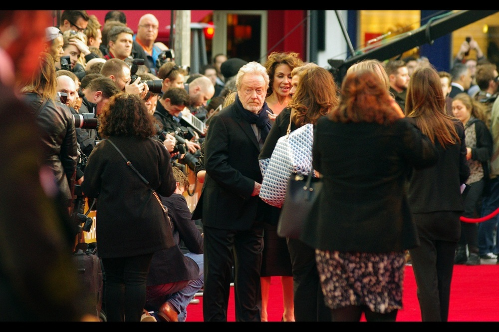 """It's definitely autumn, and yet I'm the only person here wearing a scarf. Have I peaked early?""  Our first arrival is Sir Ridley Scott, director of this film, who I've previously photographed at such premieres as  'Prometheus'  and  'The Counselor'"