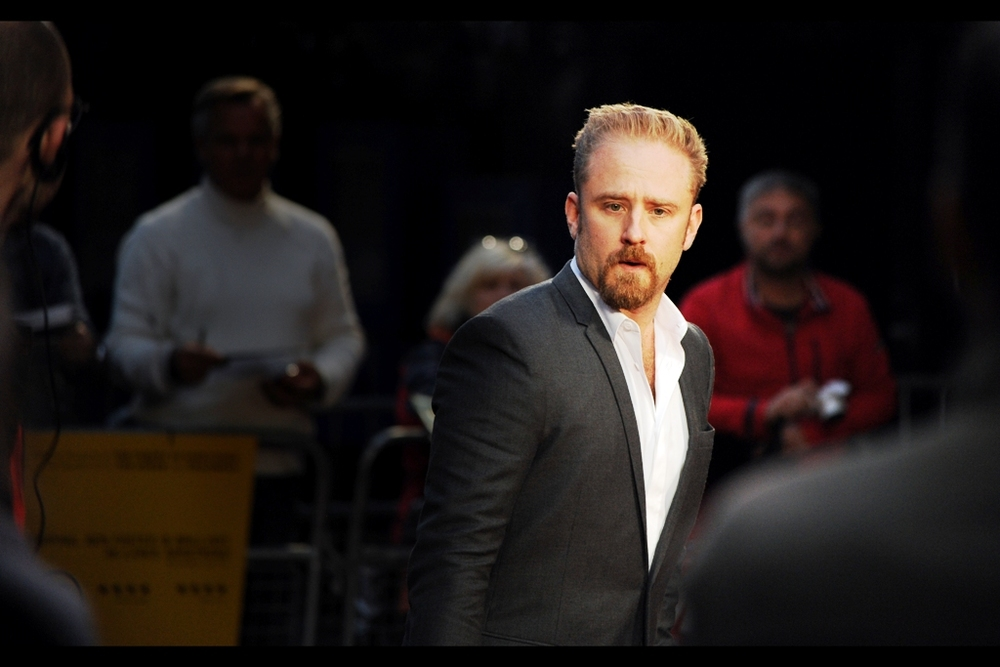 Ben Foster glares at me, defying me to call either him or Lance Armstrong (the character/real life athlete he plays in the film) a drug cheat, a bad person, or even somebody whose lack of a tie right now is anything less than an awesome fashion choice.