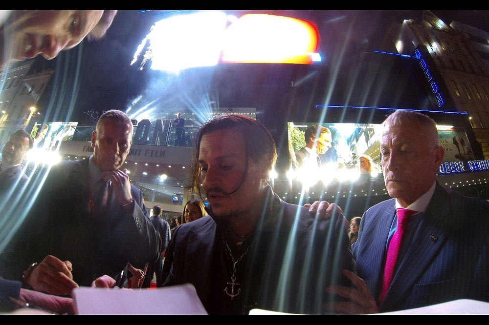 My little GoPro catches Johnny Depp at half a metre distance (woohoo!) - also, I don't think I've seen this many lens flares since I last photographed JJ Abrams at the Star Trek Into Darkness premiere, also featuring Benedict Cumberbatch.