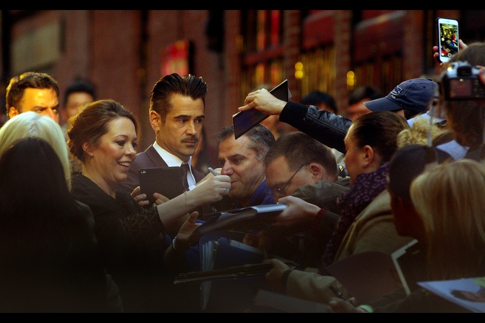 Colin Farrell appears to recognise either the look or stench of the autograph dealers reaching over the back of the fans at the front of the pen, but in more interesting (?) news a lady behind us in the crowd has absolutely gone batshit crazy and pleaded with a guy in our pen to take her camera and use it to photograph Colin Farrell, and then using every moment the guy didn't take a photo to remind him to please make sure he takes a photo. I had no idea 20 year olds cared that much about Colin Farrell... ..then I turned around and she was about 60 years old, wearing a business suit and a look of total desperation.