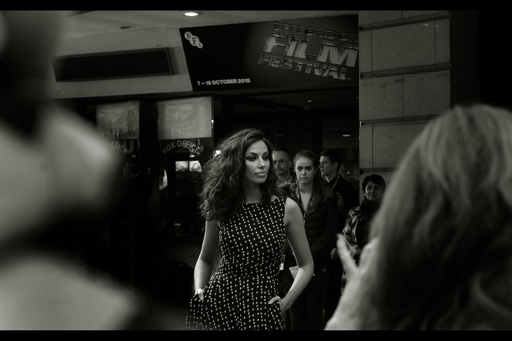 Madalina Diana Ghenea has the kind of name that doesn't easily roll off the common tongues of ill-educated autograph dealers wanting to call out to people by their full names. It's part of her charm. (As is the contrast-autofocus-detect advantageousness of her dress)