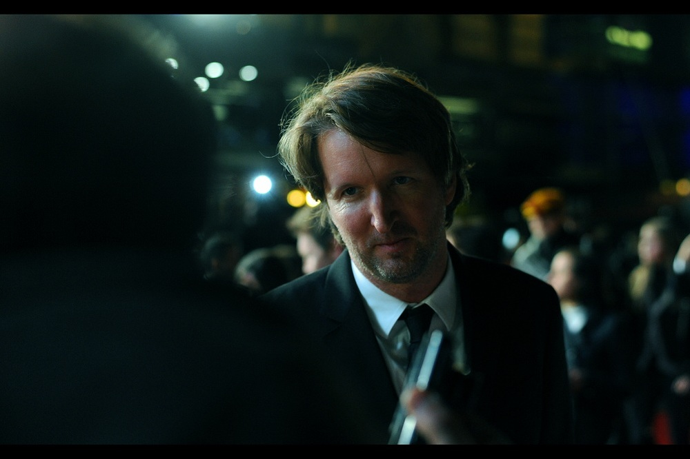 """And you're sure the beard makes me look rakishly handsome, not slightly homeless?"" Random Arrival #2 : director Tom Hooper, who won a best Director Oscar in 2011 for The King's Speech."