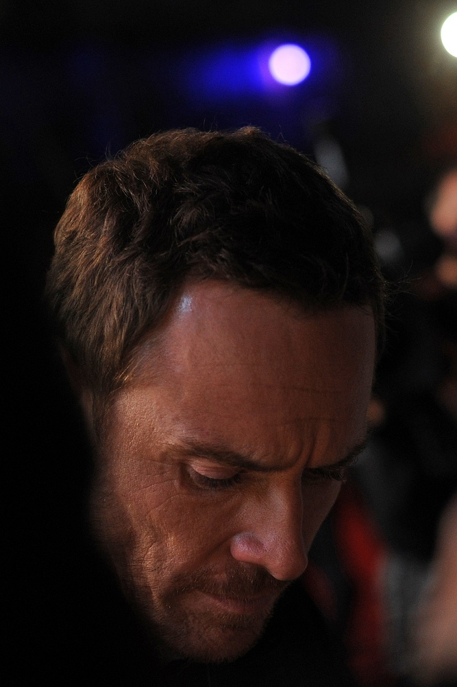 Meanwhile, Michael Fassbender is steeling himself for yet more autograph signing. Or listening to music on one of those really, REALLY small iPods they don't make a big deal about.