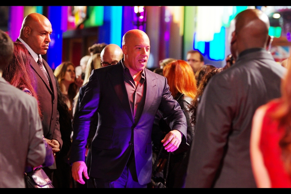 """He's not my bodyguard. Don't need one. Actually, I'm HIS. Deal with it""  Vin Diesel has come a long way from turning up to grace  the Fast and Furious (4) premiere  with barely 10minutes of his time back in 2009, to wearing moonboots and signing/high-fiving for all-comers at  last year's 'Guardians of the Galaxy' premiere ... to being a justifiable Dwayne-The-Rock Johnson-esque fan favourite and nice guy in every respect."