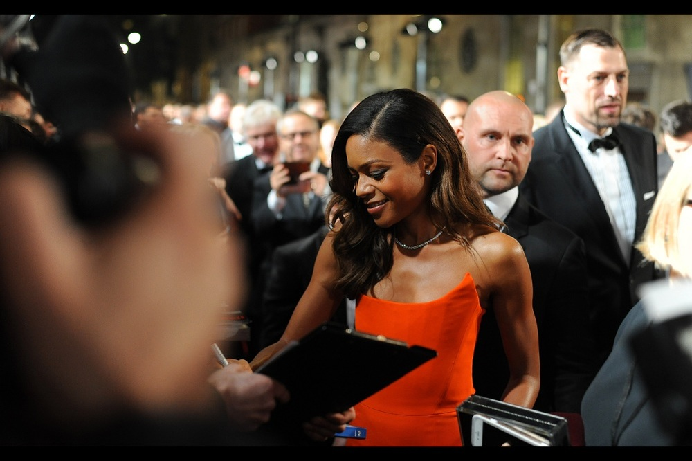 Naomie Harris' orange dress makes a nice break from the grey and bow ties on the carpet. I myself am also dressed semi-formally with a black jumper worn behind a black jacket. My beanie is navy blue, in case you're interested.