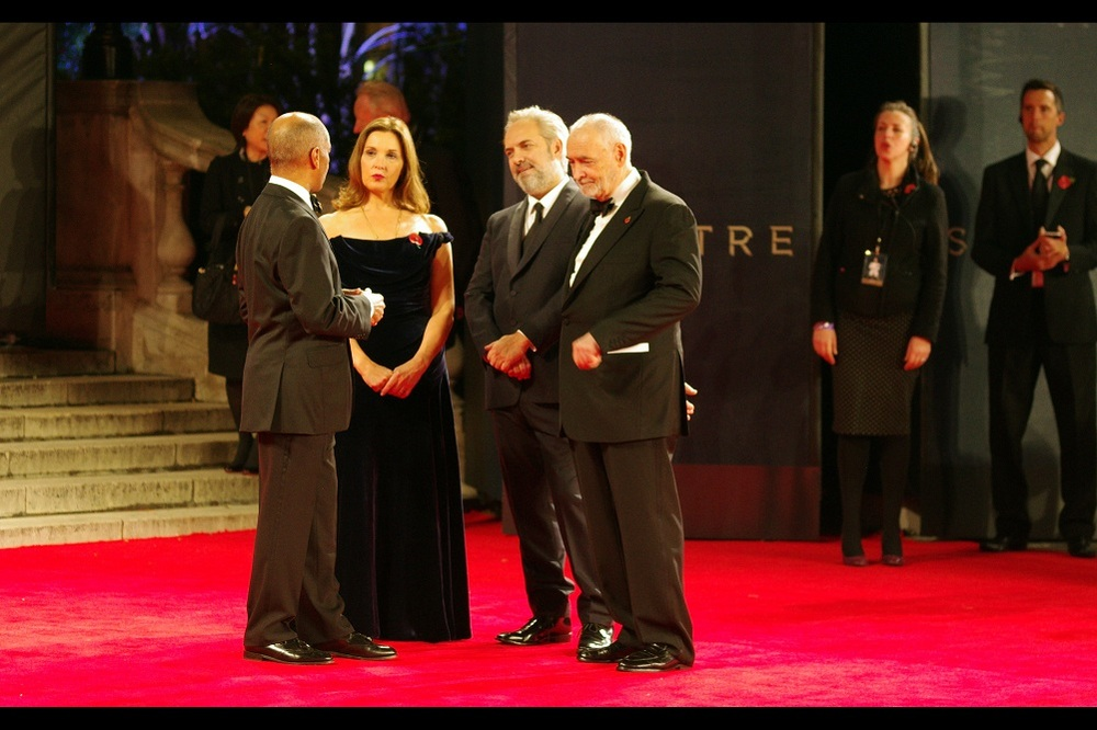 """no... I'm serious. I'm talking ALL THE MONEY""  Sam Mendes is joined by James Bond producers Barbara Broccoli and Michael G Wilson to meet Their Royal Highnesses."