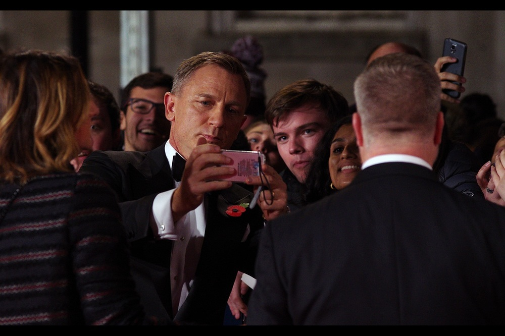"""I gotta be honest... the composition could be better. Then again, this isn't my phone""  - to the delight of pretty much everyone, James Bond himself Daniel Craig is the first to arrive, and start grabbing peoples' pink mobile phones for selfies. Or grand larceny. Or to throw against walls for being unmysoginistically unmanly."