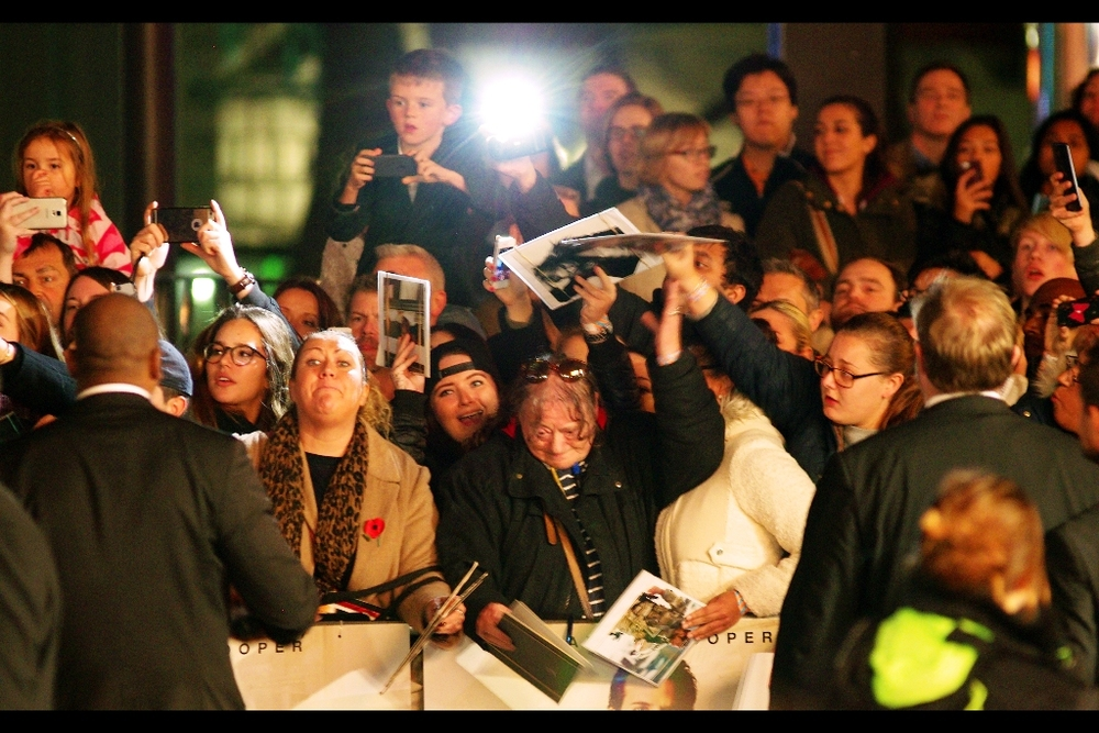 Bradley Cooper heads to sign in the far reaches, and it's a near-riot in the autograph dealer/ hunter/ collector/ mercenary pen. I now look at this photo and mostly see small kids perched on the shoulders of indulgent parents, or possibly confused total strangers.