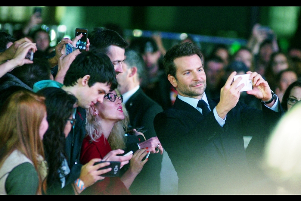 Girl : 'Please don't drop that phone. I need it to photograph Bradley Cooper...'