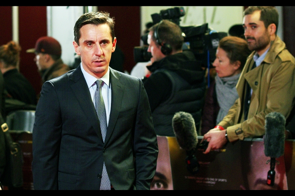 """I'll answer your question if you can answer my question : Why aren't they cheering for me?"" Former player Gary Neville arrives, looking dapper and downbeat. I've actually photographed him, plus four others from Manchester United (and more than half of One Direction) before - back in 2013 for the premiere of 'Class of 92'"
