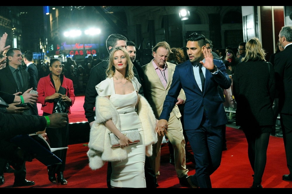 Wireimage informs me that these two are Radamel Falcao and Lorelei Taron, and while I could probably guess as to which one is which, right now I'm too tired.
