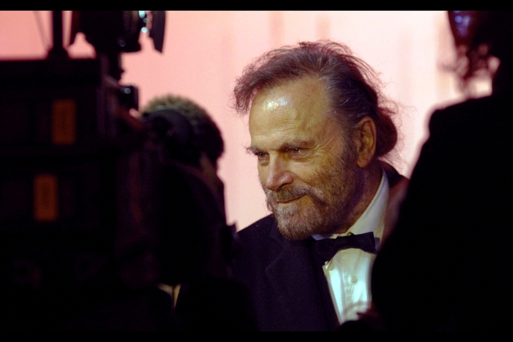 """Don't I look familiar to you?"" I would say no.. but then I've just looked at Franco Nero's filmography on imdb.com and apparently he was in both Tarantino's ""Django Unchained"" and... Die Hard 2 back in 1990? He and Vanessa Redgrave are also partners."