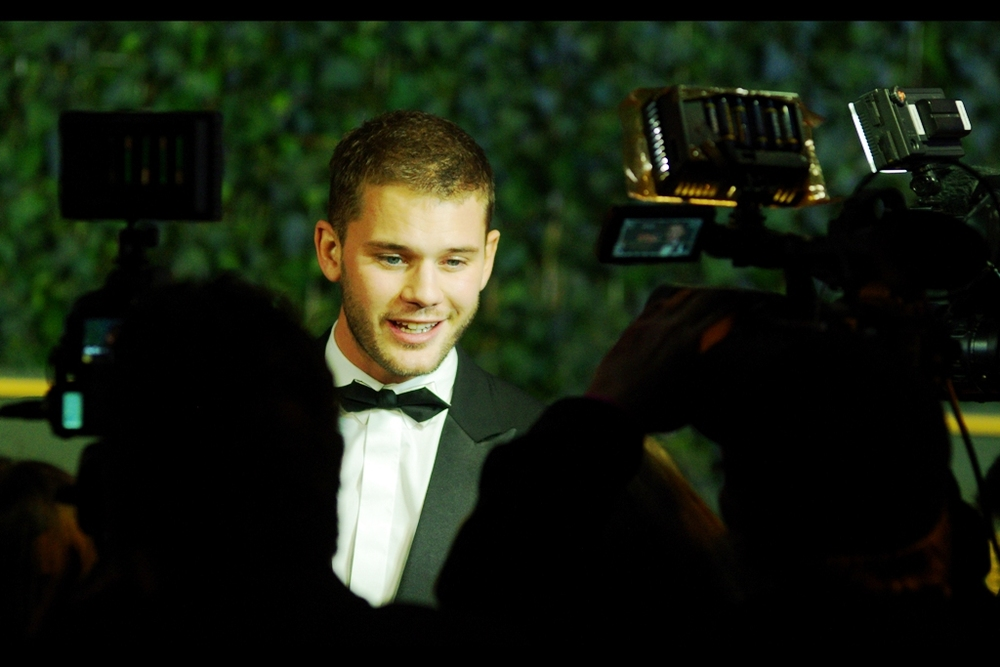 """Yes, I do think 'War Horse' needs its own cinematic universe, now that they're doing one of those for pretty much every movie"". Jeremy Irvine was in Steven Spielberg's ""War Horse"", though I last photographed him at the premiere of 'Bad Education' this year."