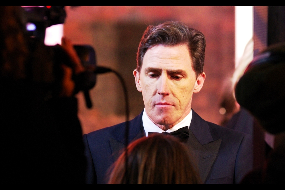 """My gosh you're small. I'll answer your question... but only after I've fully processed this realisation"" I believe this is Rob Brydon, and I believe he is/was the host of the event."