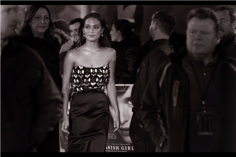 After failing to photograph Alicia Vikander because (a) she wasn't at last year's  'Testament of Youth' premiere , (b) neither she nor I was at ths year's 'The Man from U.N.C.L.E' prmiere, and (c) she and I were separated by cruel event design of  Sunday's British Independent Film Awards ... I've finally photographed her. Eddie Redmayne on the movie poster seems a lot less happy about this than I am.