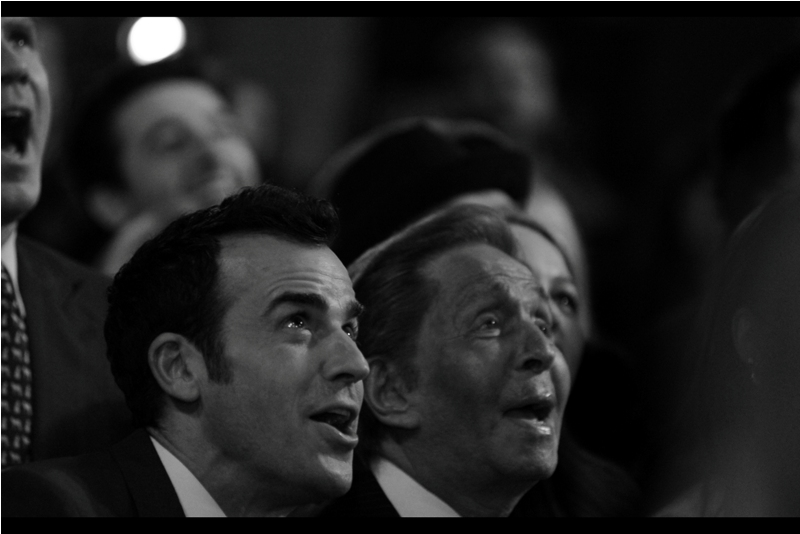 Justin Theroux (left) and fashion designer Valentino (right) attempt to see the camera in low earth orbit in order to pose.