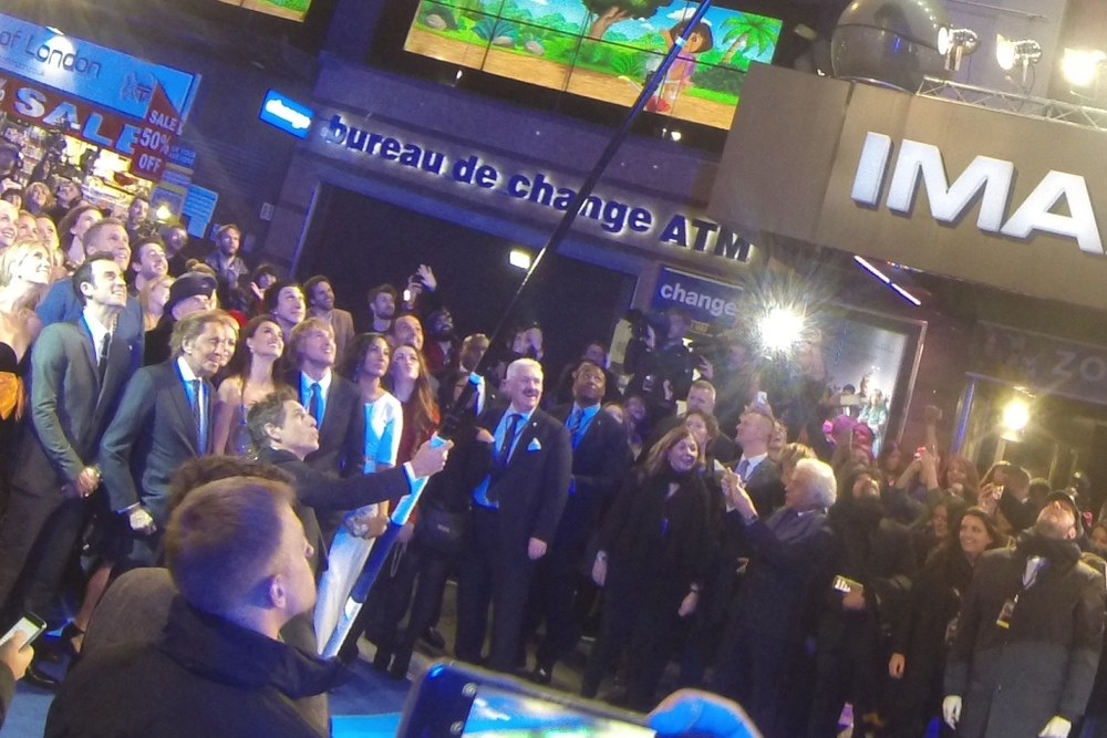 """I'm going to be honest... at this distance I can't even tell if if my mobile is turned on"" - Ben Stiller holds an 8.6metre selfie stick as Kristen Wiig, Justin Theroux, Valentino, Penelope Cruz, Owen Wilson, Adam Driver and other guests observe"
