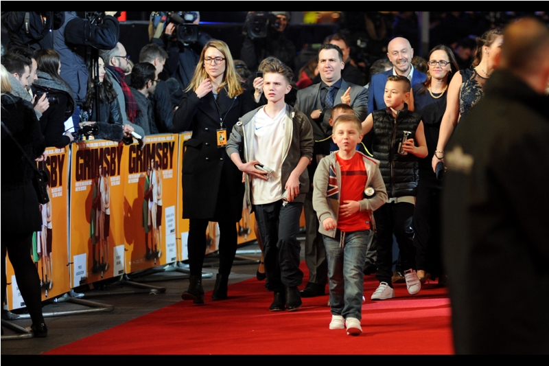 "Norman ""Nobby"" Grimsby's kids walk the red carpet with a mixture of insouciance, profanity, and confusion as to where the women in swimsuits came from or went to."