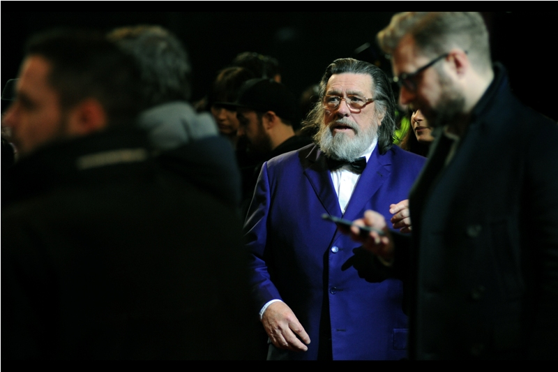 """What do you mean ""Am I In This Film"". Firstly, that depends on what you mean by 'This Film' and secondly of course I am. Still.... if you could answer me the first question I'd appreciate it"" - a nearby website assures me that this is Ricky Tomlinson."