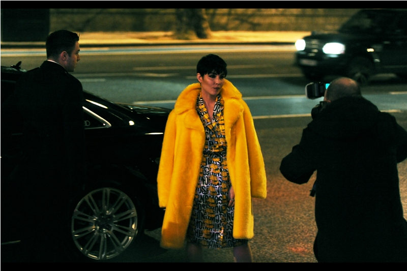 "Amazingly, not only do I know who this is, but her yellow-orange jacket helpfully assisted my cameras' failing autofocus systems! She's Noomi Rapace, best known for being in the Swedish version of The Girl With The Dragon Tattoo and Ridley Scott's ""Prometheus"""