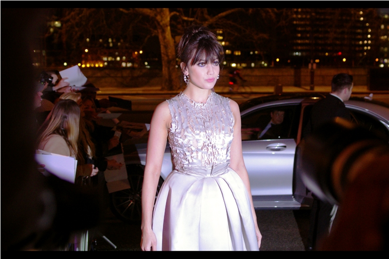 I think this might be model Daisy Lowe.. but the dude in the limo behind her has seen somebody potentially even more exciting.