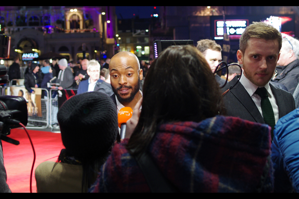 "Arinze Kene, left :  ""What was it like working with Ben as a Director? I'm going to wait to hear what he says it was like working with me first, if you don't mind....""  Ben A. Williams, right :  ""Forget about that... is that lady interviewing me wearing a BLANKET?"""