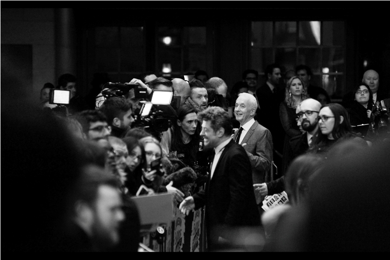 Amazingly, a part of the Paparazzi cordon has decided to take a break from their time spend busily remembering what shoulder to ask people to turn and look over, and I snatch a long range shot of Anthony Daniels behind Andy Serkis.