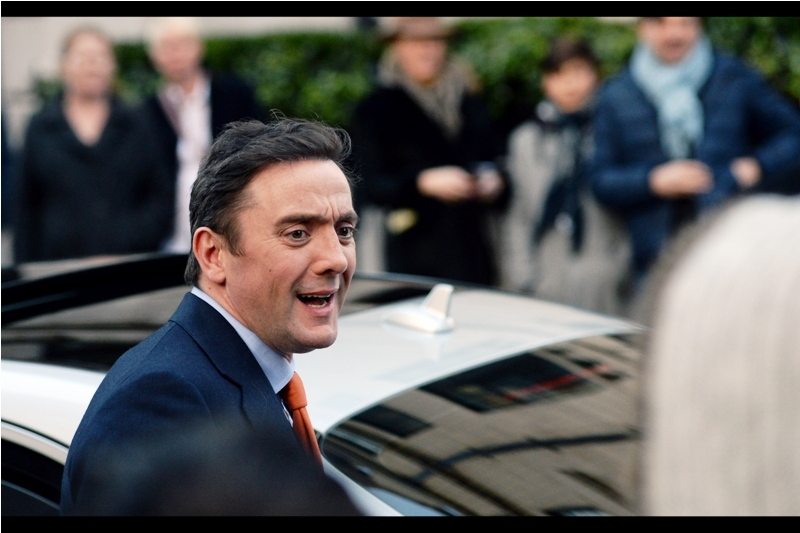 "Peter Serafinowicz has some very interesting movie credits to go with the uniqueness of his orange tie, among them : the anal housemate of Simon Pegg / Nick Frost in Shaun of the Dead (2004), the voice of Darth Maul in Star Wars the Phantom Menace (1999), plus he's the guy who says ""what a bunch of a-holes"" about the Guardians of the Galaxy. The tie is pretty cool, too."
