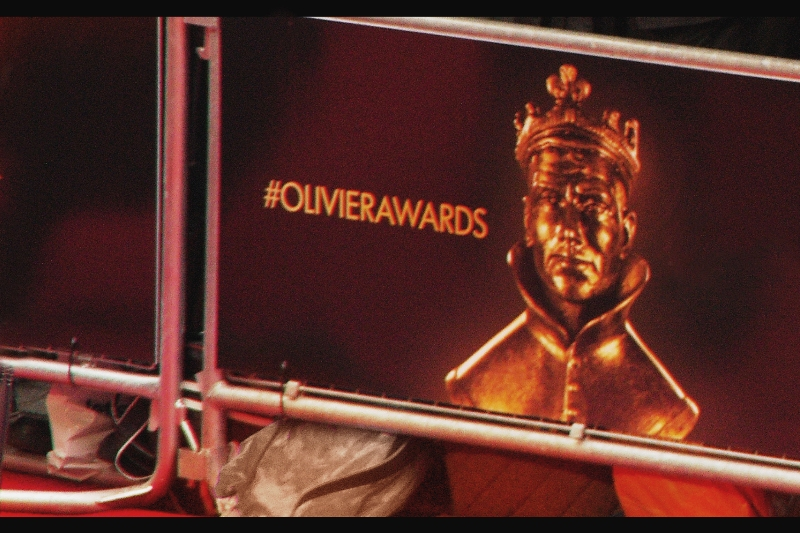 #AngryMascot. Actually, I'd like to think that due to my tireless campaigning over the past two years to draw attention to the intimidating nature of Sir Laurence Olivier's statue, the face on this year's award seems slightly more benign. (You're welcome, worthy recipients!)