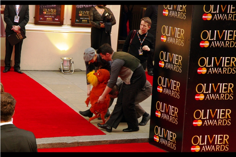 Either this is The Lorax, or maybe Dame Judi Dench REALLY doesn't want to be asked for an autograph at this event.
