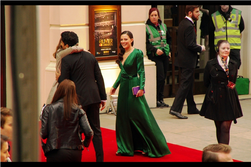 "Amazingly, I not only notice a sheer silky green dress on a red carpet, but I've actually heard of the person who's wearing it! Lara Pulver played Irene Adler in the Sherlock episode ""A Scandal in Belgravia"" possibly the best standalone episode of any TV series I've seen.   edited to add : Lara Pulver ended up winning Best Actress in a Supporting Role in a Musical Award for 'Gypsy'"