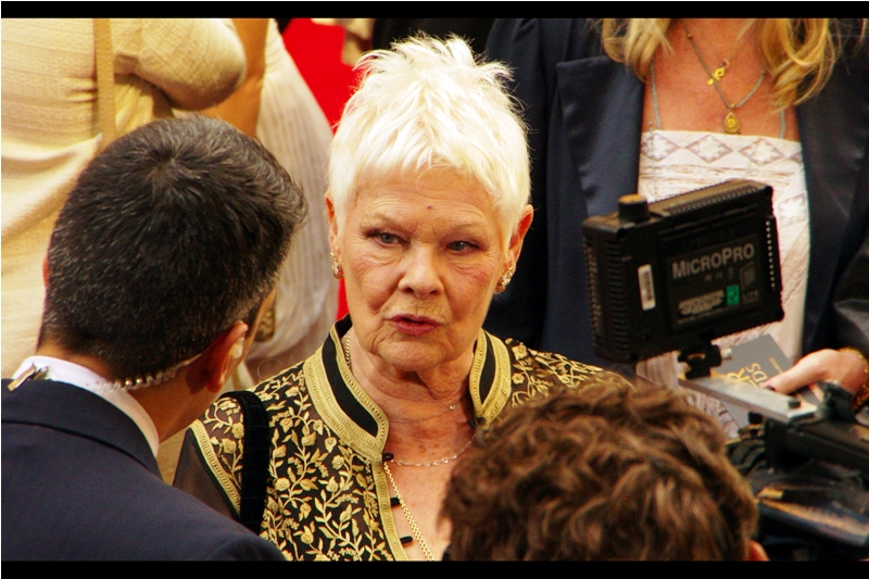 """Just because you're wearing a twirly earpiece doesn't make you a secret agent, son""  Dame Judi Dench was ""M"" in most of the Pierce Brosnan and several Daniel Craig James Bond films"
