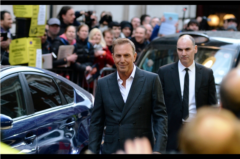 "Kevin Costner's look says quite clearly  ""I'll swap you two autographs for a tie. The security guy behind me refused to give me his...."" . I, of course am wearing a rainproof jacket and t-shirt at this event."