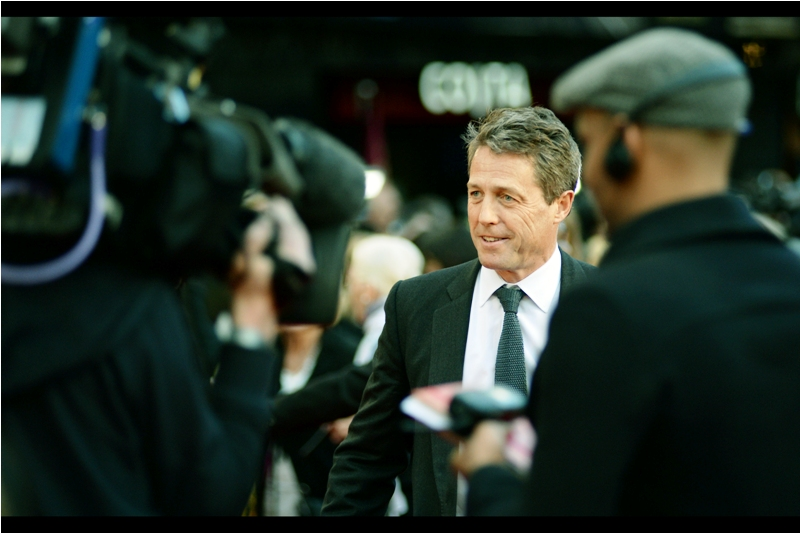 "Hugh Grant has arrived, and he's looking (for want of a better word) very British. I last photographed him at the premiere of the (I feel) underrated  ""Cloud Atlas"""