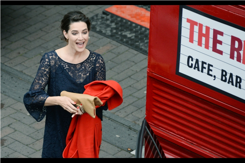 "I was lucky I photographed ""random pretty woman holding something red"" next to a closed street cafe. Turns out she's almost certainly Megan Maczko, and she's in this movie!"