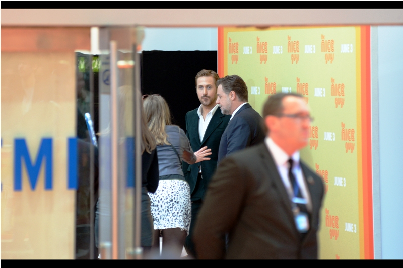 Shootin' Ryan Gosling diagonally through a doorway just after he's posed for an indoor group shot. Me? Desperate? No, not at all...  ... and then he entered the cinema