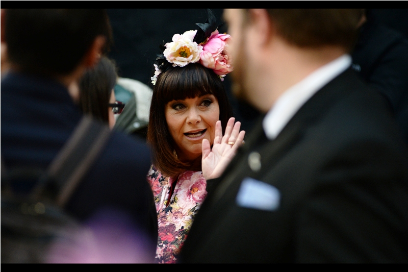 Dawn French is the creator of Absolutely Fabulous, and she's also wearing what can only be described as a summer garden and a potplant hairdo. Given it's in imminent danger of starting to rain at any moment here, it seems appropriate.