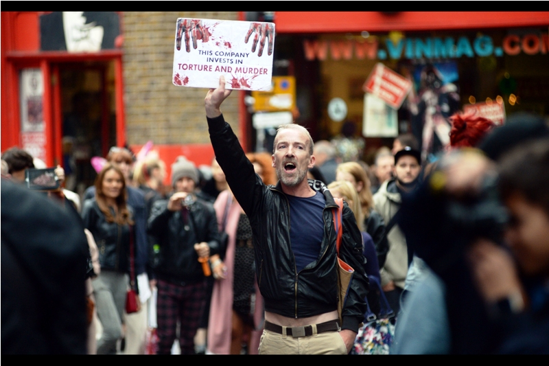 "Great sign, and the guy holding it was very passionate. But on the other hand, he was holding it up for over an hour, and gave no indication of who exactly ""This"" company he referred to was. Is London Fashion Week a company? Name names if you're going to throw accusations, I say."