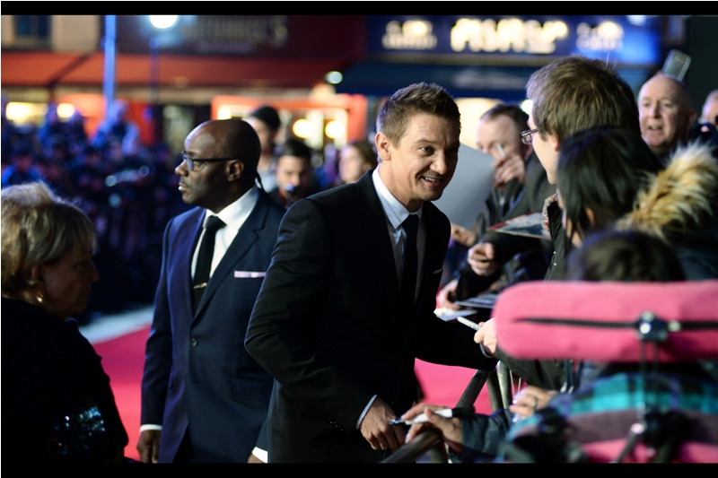 Meanwhile... Jeremy Renner : Hey, you want my autograph? Security behind him : I know Renner is a member of the cast of the biggest entertainment franchise on the planet, but I wonder if Amy Adams needs a bit more protection...?