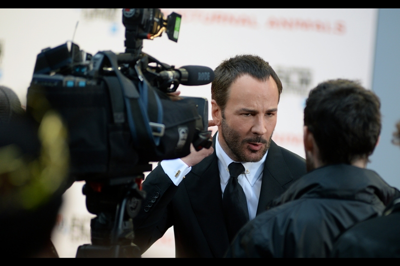 """And you go out in public wearing a... a... is it called 'puffy jacket'? Is that what it's called? And people date you and everything??""  Tom Ford doesn't merely have film and photographic credentials, he's also got a major fashion label he's running as a side-project. It's called ""TOM FORD"". You might have heard of it."