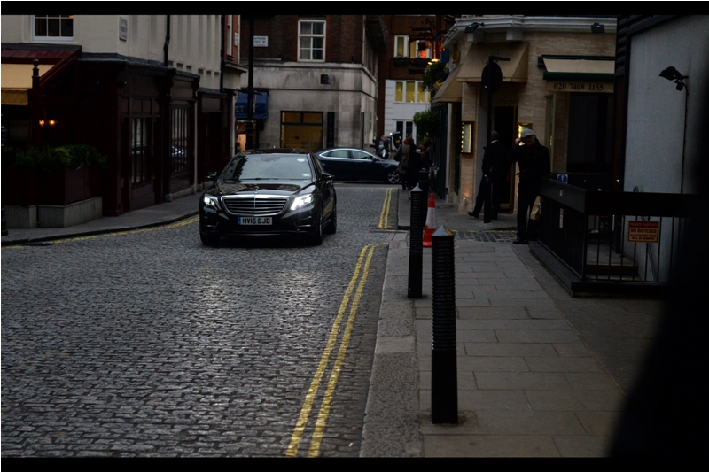 But hark, which light through yonder cobblestone driveway shows? It is a Merc, and stars are the contents. (Either that, or it's just the locals going out for champagne for their butlers or caviars for their cats or something)