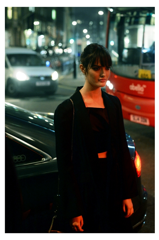 I'm trying to make this look sexy. (edited to add : she's    Sam Rollinson, and mostly succeeding under the circumstances)