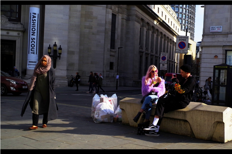 """If you move back closer to that bit of street garbage, my photo will make a statement about something really profound. That'll make it Fashion AND Art, baby""  (or fART for short, and yes damnit I'm copyrighting that)"