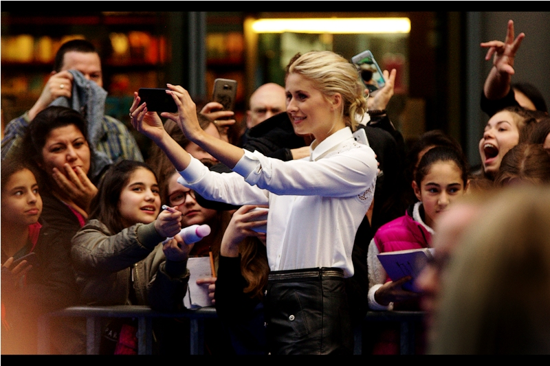 "Lena Gercke is the host of Austria's Next Top Model (that's the country with the Mozart, not the one with the Koalas) and is also the voice of "" Schlumpfblüte"" ('Smurfblossom') in the movie."