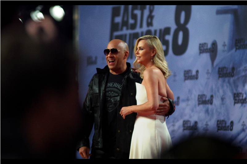 The only thing my brain is processing right now is that bald guys with leather jackets who wear sunglasses at night can put their arm around Charlize Theron. And I'm not wearing either right now. Thanks, brain.
