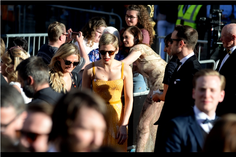 But before Brian May's hair had a chance to obscure views of Ruth Wilson, there were about a hundred people and a woman wearing sunglasses and a yellow dress.