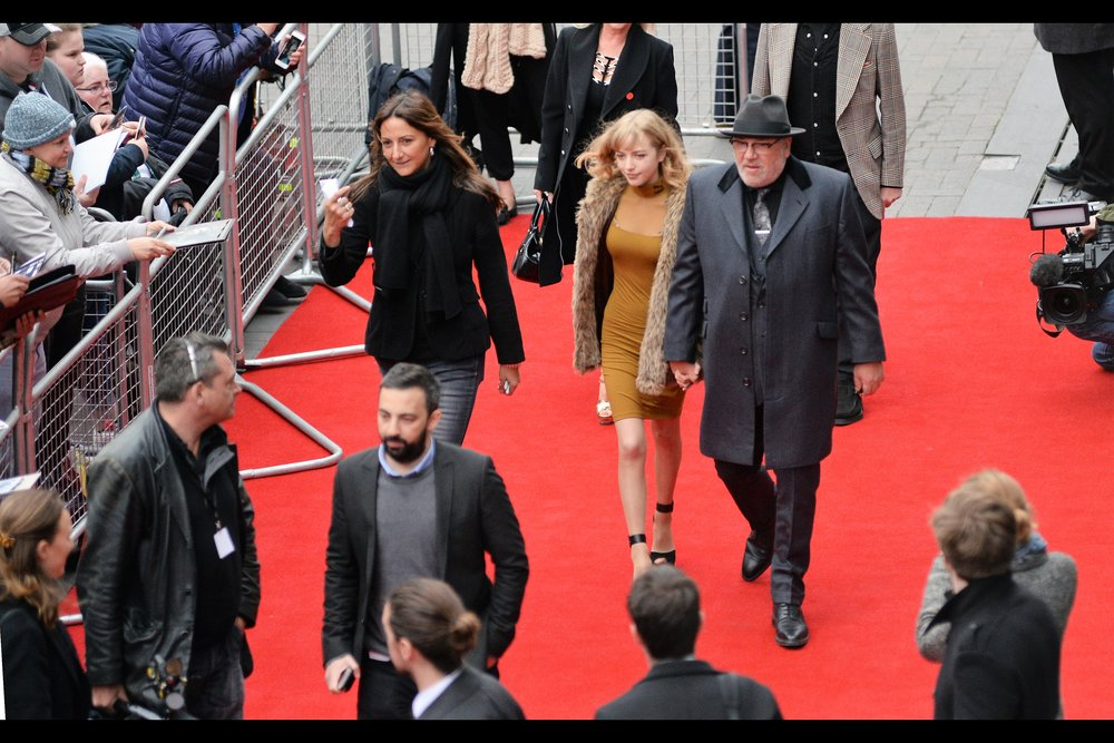 Actor Ray Winstone arrives, accompanied by a wife so age-inappropriate it turns out to be his daughter, Ellie Rae Winstone. (I last photographed him at the premiere of  ' The Gunman'   a few years ago now)