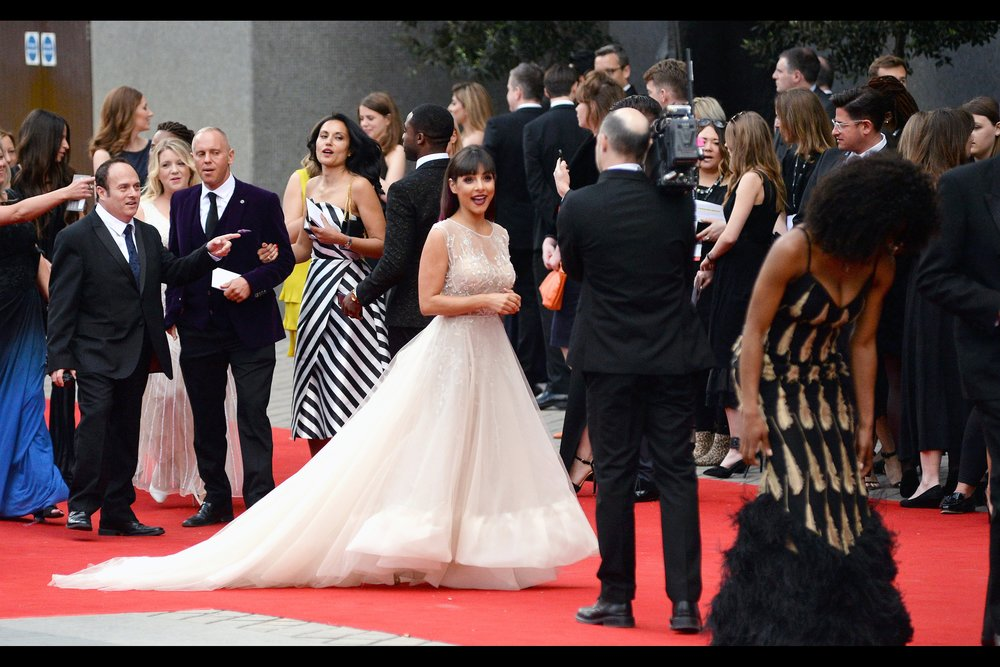 """If anyone steps on this dress, they're going to find out why I'm happy that this is a red carpet"".  I don't know who Roxanne Pallett is, but there's enough room under that dress to hide any number of weapons."