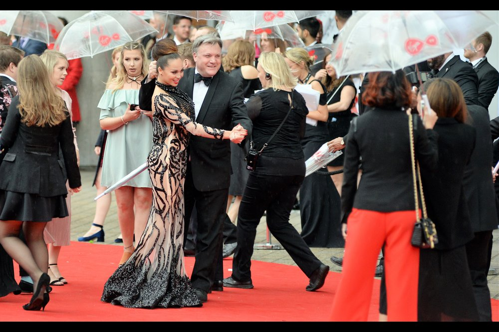 Apparently Ed Balls is famous... for something? I mean, his partner's dress is awesome and the dancing pose is neat, but apparently HE's the one that everyone around me is excited about seeing? I get that his name is intrinsically funny, but other than that...?