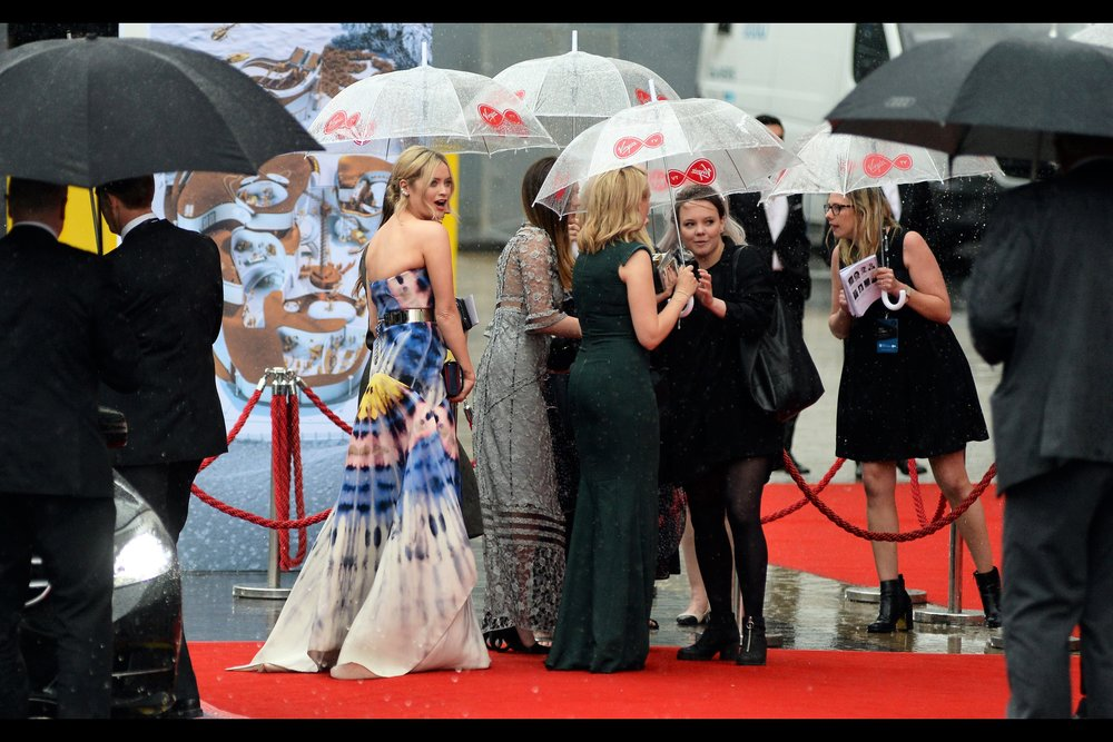 """Not one of you people who organised the umbrellas considered that women might be wearing dresses bigger than a tight swimsuit to this event?"""